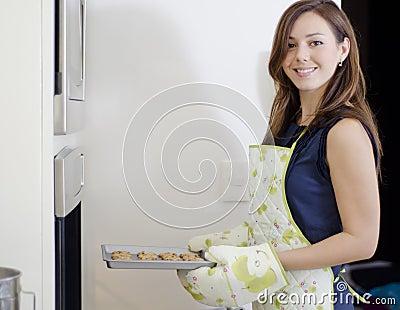 Pretty housewife baking cookies