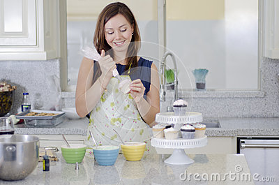 Pretty housewife making cupcakes