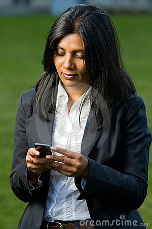 Pretty indian girl using mobile phone