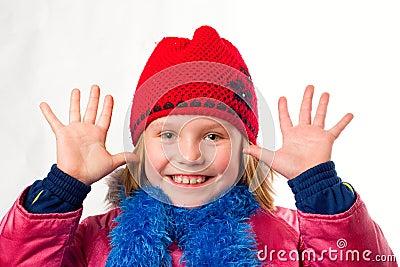 Pretty joyful little girl dressed winter clothes