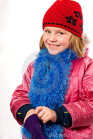 Pretty joyful little girl dressed winter clothes i