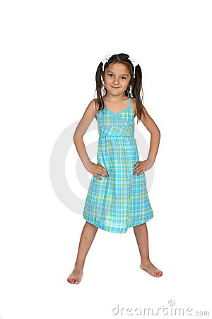 Pretty kindergarten aged child in blue dress