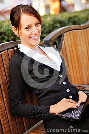 Pretty lady with open smile using laptop