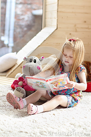 Free Pretty Little Blonde Girl Sits Near Soft Toy On Carpet Royalty Free Stock Photography - 42649787