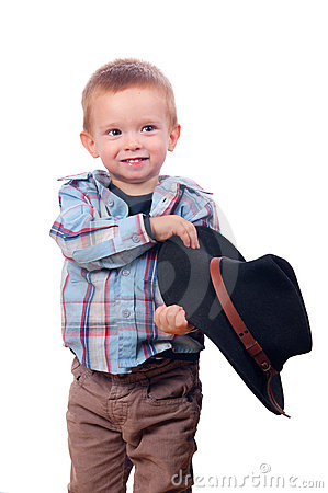 Pretty little boy plays with cowboy hat