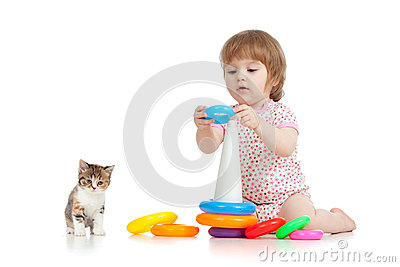 Pretty little child or kid playing with color toy