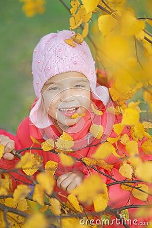 Pretty little girl in autumn park