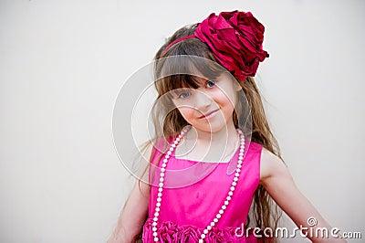 Pretty little girl in beautiful pink dress