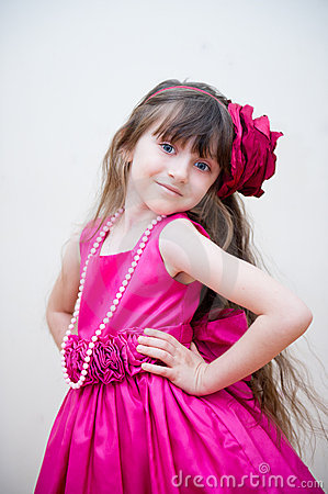 Pretty little girl in beautiful pink dress