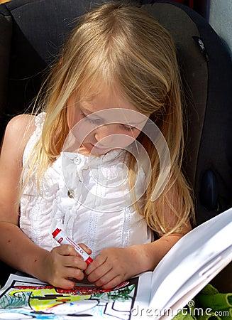 Pretty little girl colouring