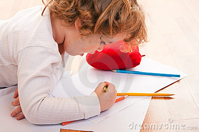 Pretty little girl drawing