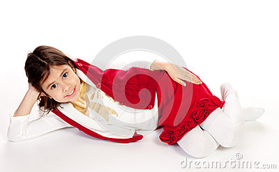 Pretty little girl dressed in red and white