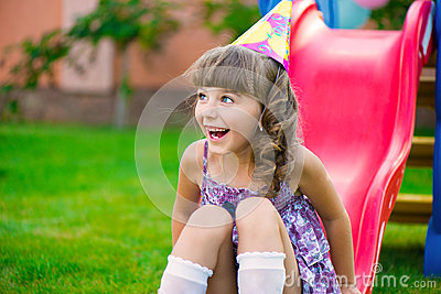 Pretty little girl having fun on playground