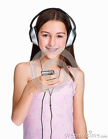 Pretty little girl hearing music over headphones