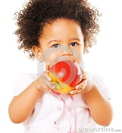 Pretty little girl holding an apple