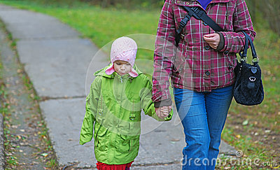 Pretty little girl with mother