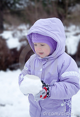 Pretty little girl in the park, winter