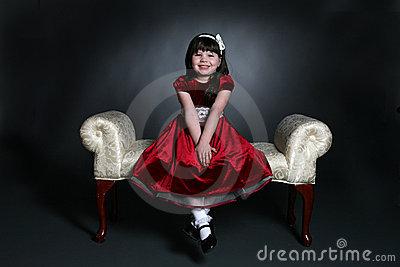 Pretty little girl in red holiday dress