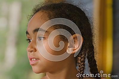 Pretty little girl staring off