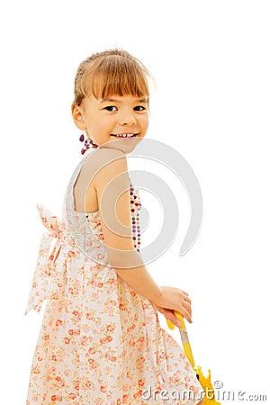 Pretty little girl in sundress with umbrella