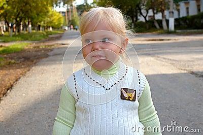 Pretty little girl walk in the park.