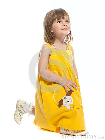 A pretty little girl in a yellow dress