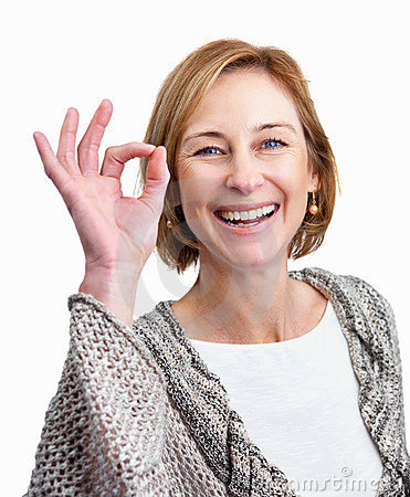 Pretty middle aged woman showing the ok sign