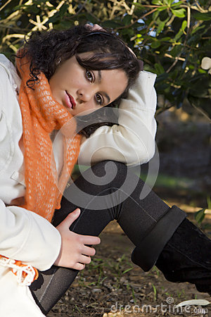 Pretty model with brown eyes sitting outside