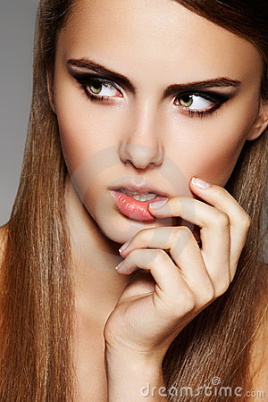 Pretty model with luxury make-up, french manicure