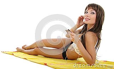 Pretty model wearing black bikini on white