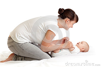 Pretty mother doing gymnastics her baby infant