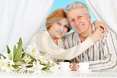 Pretty older couple resting in the bedroom