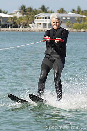 Free Pretty Older Lady Water Skiing By Nice House. Royalty Free Stock Images - 19448199