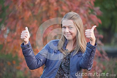 Pretty positive girl with thumbs up