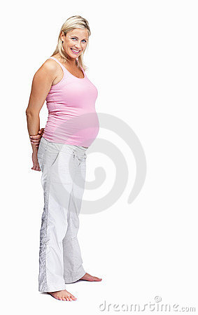 Pretty pregnant woman standing against white