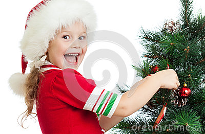 Pretty preschool child decorating Christmas tree