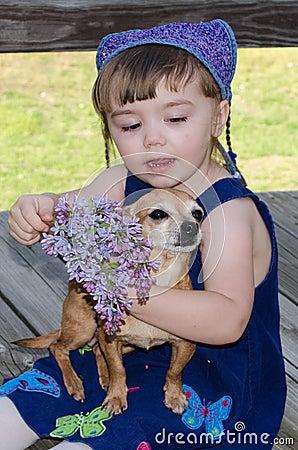 Pretty in purple child and chihiahua pet