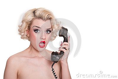 Shocked blond beauty on vintage telephone
