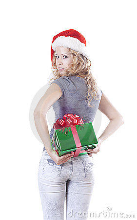 Pretty Santa girl hiding a present gift for