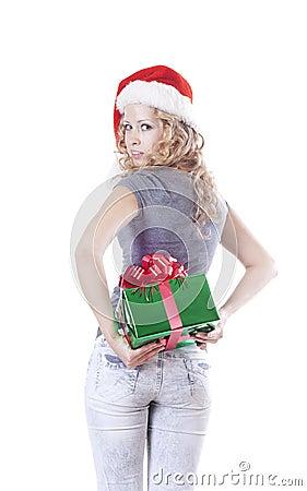 Pretty Santa girl hiding a present gift for