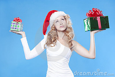 Pretty Santa girl hiding a present gifts for New Y
