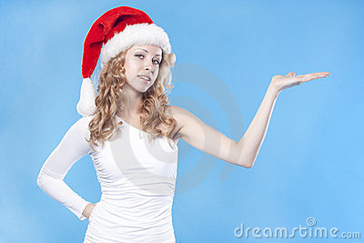 Pretty Santa girl presenting your product
