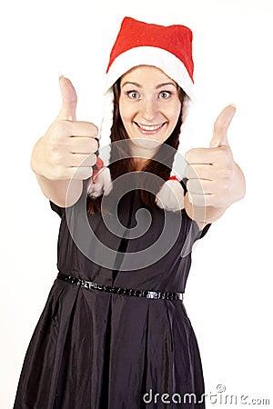 Pretty Santa girl showing hand ok sign