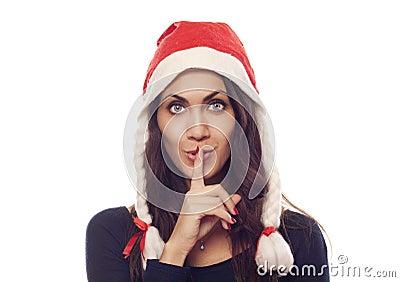 Pretty Santa woman saying shh