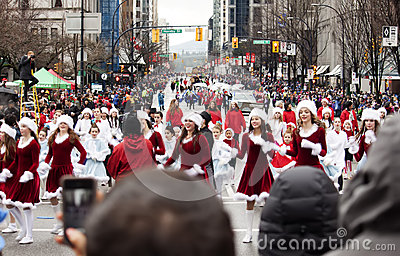 Pretty santas at christmas parade Editorial Photography