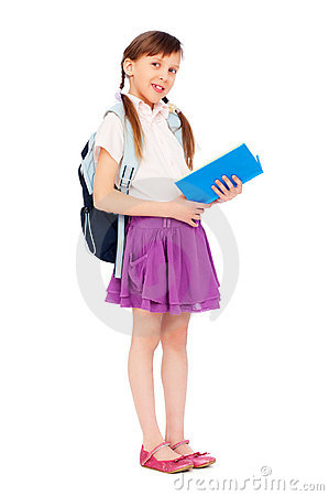 Pretty schoolgirl reading book