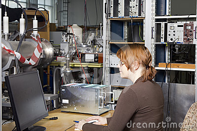 Pretty scientist in nuclear- electronic laboratory