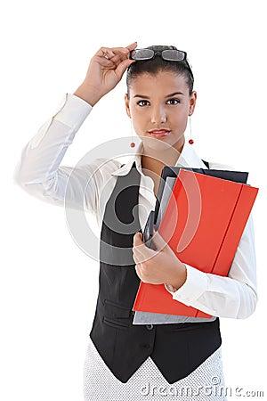 Pretty secretary with folders
