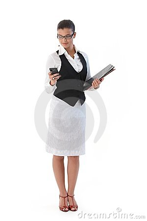 Pretty secretary with mobile and folders