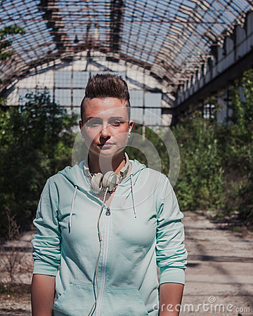 Pretty short hair girl in an abandoned factory Stock Photo